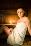 Pretty woman relaxing in the sauna Stock Photos