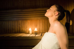 Pretty woman relaxing in the sauna Royalty Free Stock Photography