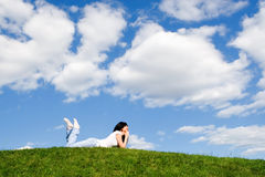 Pretty woman rest on the grass Stock Images