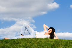Pretty woman rest on the grass Royalty Free Stock Photos