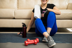 Pretty woman resting from working out Royalty Free Stock Photo