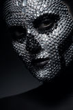Pretty woman in rhinestones with skull face. In studio Royalty Free Stock Images