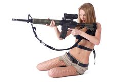 Pretty woman with rifle Royalty Free Stock Photos