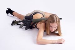 Pretty woman with rifle Stock Images