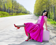 Pretty woman on the road Royalty Free Stock Photo