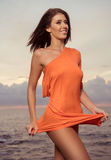 Pretty woman on the rocks Royalty Free Stock Photography