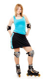 Pretty woman on roller skates. Beautiful woman in roller skates isolated on white stock photo