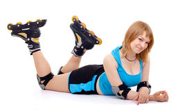 Pretty woman on roller skates Royalty Free Stock Images