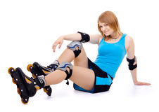 Pretty woman on roller skates. Beautiful woman in roller skates isolated on white royalty free stock images
