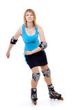 Pretty woman on roller skates. Beautiful woman in roller skates isolated on white stock photography