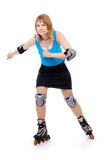 Pretty woman on roller skates. Beautiful woman in roller skates isolated on white royalty free stock photos