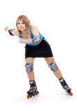 Pretty woman on roller skates Stock Photos
