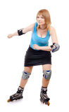 Pretty woman on roller skates Stock Photo
