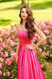 Pretty woman in roses buches Royalty Free Stock Image