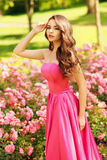 Pretty woman in roses buches Stock Photo