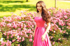 Pretty woman in roses buches Royalty Free Stock Photo
