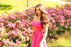 Pretty woman in roses buches Royalty Free Stock Photography