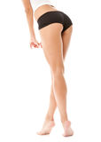 Pretty woman's legs and ass on white Royalty Free Stock Image
