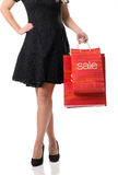 Pretty woman and  sale, detail photo, female legs with sale bags Stock Photo
