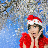 Pretty woman in santa cap on winter nature Stock Image