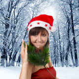 Pretty woman in santa cap on winter nature Stock Images