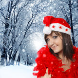 Pretty woman in santa cap, winter nature Royalty Free Stock Photos