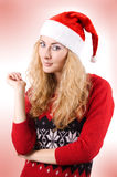 Pretty woman in Santa hat Stock Image