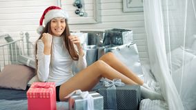 Pretty woman in santa hat astonished with the surprise inside of the red box.  stock video