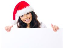 Pretty woman in Santa hat displaying a sign Stock Images