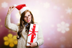 Pretty woman in Santa hat holding giftbox on Stock Images
