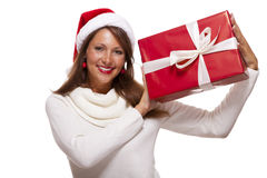 Pretty woman in a Santa hat with a large gift Royalty Free Stock Photos