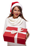 Pretty woman in a Santa hat with a large gift Royalty Free Stock Photo