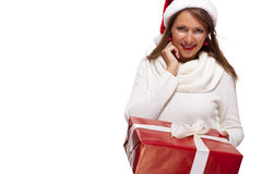 Pretty woman in a Santa hat with a large gift Stock Images
