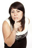 Pretty woman saying shh Stock Photo