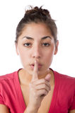 Pretty woman saying shhhhh quiet Royalty Free Stock Photography