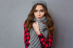 Pretty woman with scarf and hat Stock Images