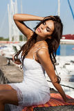 Pretty woman on the sea background Stock Photography
