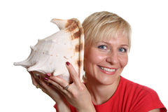 Pretty woman with seashell Stock Photo