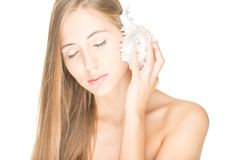 Pretty woman with seashell isolated on white. Royalty Free Stock Photo