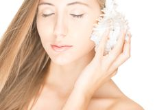 Pretty woman with seashell isolated on white. Royalty Free Stock Image