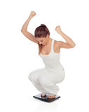 Pretty woman on seeing his new weight scale Stock Photos