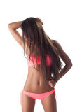 Pretty woman in sexy rose swimsuit and long hairs Royalty Free Stock Photo