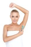 Pretty woman shaving armpit with razor. Royalty Free Stock Photo