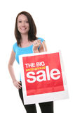 Pretty Woman Shopping. A pretty young woman shopping with a large sale bag Royalty Free Stock Photo