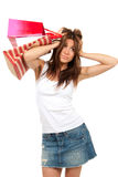 Pretty woman with shopping bag full of presents Stock Photo