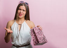 Pretty woman with a shopping bag Stock Image