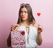 Pretty woman with a shopping bag Stock Images