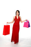 Pretty woman with shopping bags. Pretty woman with shoppiong bags and wearing a red gown Stock Photos