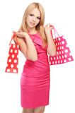 Pretty woman with shopping bags isolated on white Stock Photo