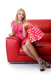 Pretty woman with shopping bags isolated on white Stock Images